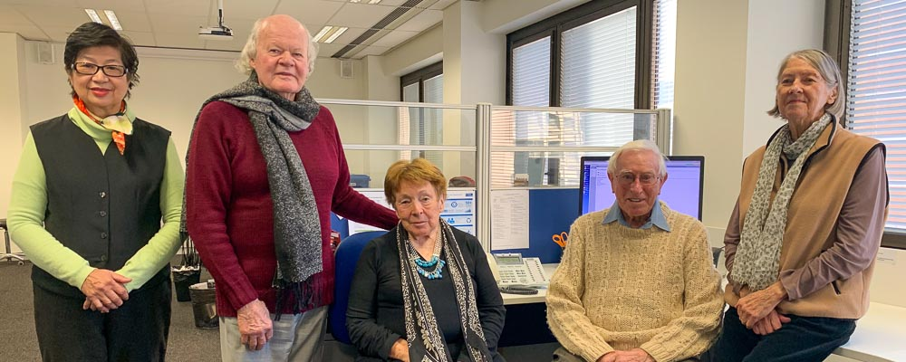 Image of five MDFA volunteers in the Sydney office