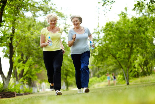 Image of two older women jogging.