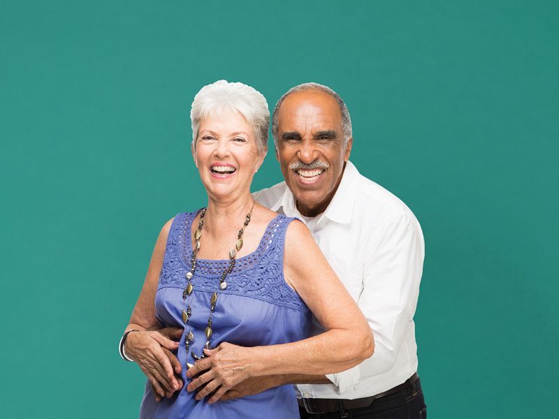 Image of a couple smiling at the camera