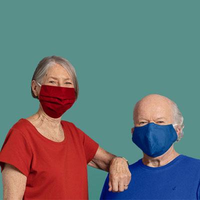 Man and a woman wearing COVID masks